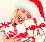 Woman with santa hat holding gift boxes