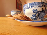 cup of tea with chocolate chip cookie on saucer | hot drink