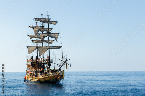 Fotobehang Schip pirate ship with tourists at sea