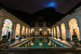 Colonial Italian architecture Lage palace at night with the Corcovado mountain behind
