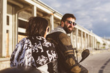 Couple on road trip with motorcycle