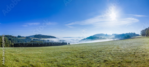 foggy rural landscape in morning in the eifel - 123849811