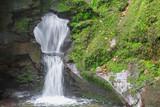 Fototapety Waterfall at St Nectans Glenn near Tintagel in northern Cornwall.