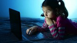 Teen girl working at laptop, the Internet play in the online entertainment game