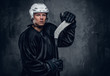 Portrait of hockey player with the gaming stick.