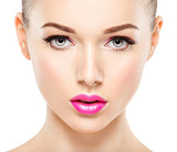 Closeup face of beautiful woman with pink lips