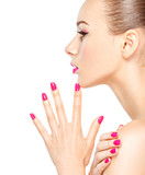 face of a beautiful  girl with pink  nails on white background