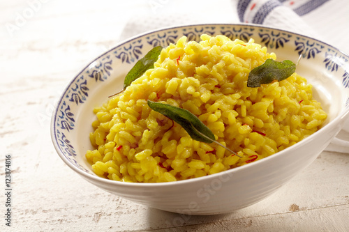 Delicious yellow rice with sage in bowl