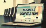 Business Cooperation on Laptop in Conference Room. 3D.