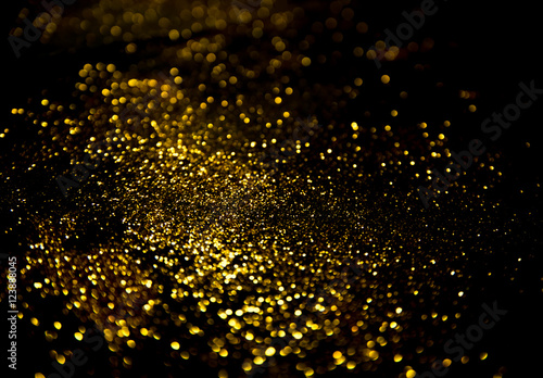 Billede gold glitter lights on black background.