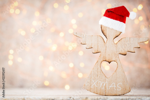 Christmas decor with angel santa hat. Vintages background. - 123912617