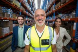 Portrait of warehouse team standing together