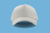 Closeup of the fashion white cap isolated on blue background.