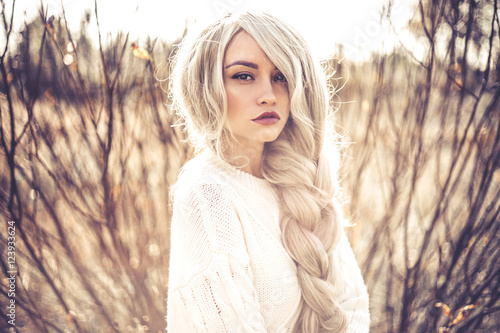 Beautiful lady in autumn landscape - 123933624