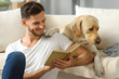 happy man with book and dog