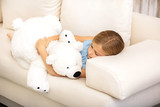 Cute child napping with soft toy