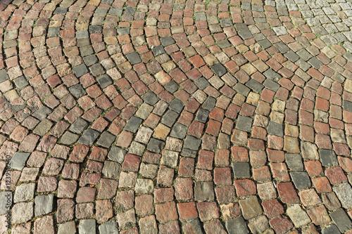 Old street paved with cobblestone. Paris, France Photo by Aliaksandr Kazlou