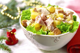 Festive chicken salad with pineapple in a white bowl.