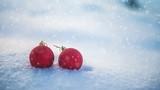 Christmas balls on snow and snowfall slowmotion. Seamless loop 4k UHD (3840x2160)