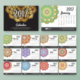 12 month desk calendar template for print design with colored Mandala background. 2017 calendar design start with Sunday. 7x5 inches size with bleeds vector illustration
