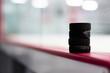 Hockey pucks along the boards