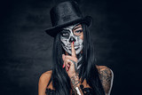 A woman with skull make up. - 123984402