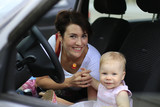 Small cute baby and mom in a car