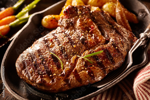 Serving of grilled steak with potatoes