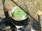 fish soup a bowler hat over a campfire after a successful fishing