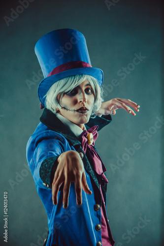 Plagát Sad gesticulating circus actor in blue tuxedo.