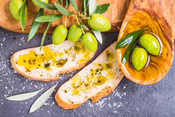 Olive oil and bread, olives top view.