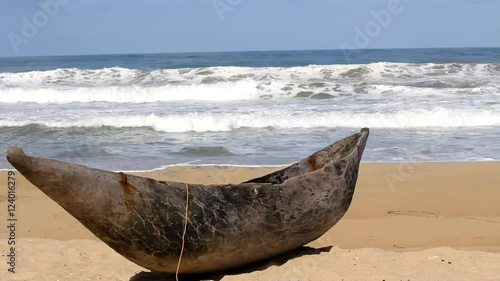 Fotobehang Overige Traditional wooden hand made African / Malagasy fishing boat - piroga on the sandy beach of Indian ocean in Madagascar, Africa