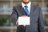 Businessman holding a blank card