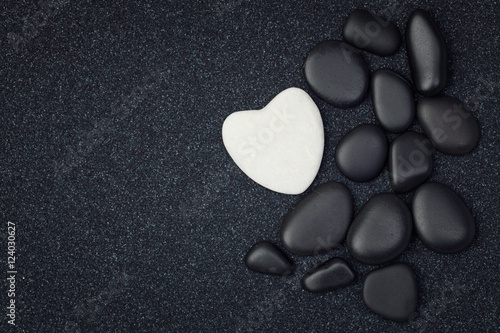 Foto op Canvas Zen Black stones with black zen heart shaped rock on grain sand