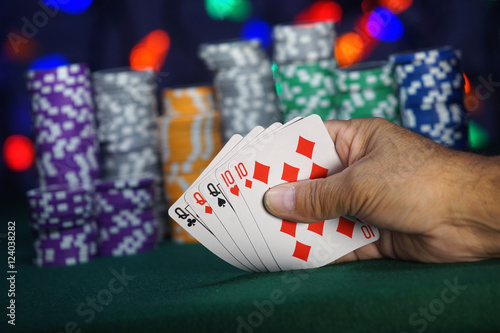 Plakat Hand holding a Full-house in the card game of poker