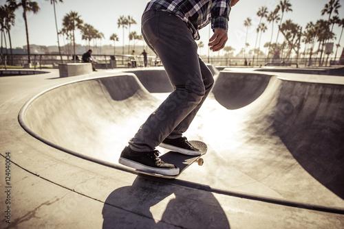 Skater boy practicing at the skate park Poster