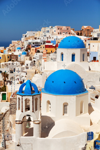 Foto op Canvas Landscape of Oia town in Santorini, Greece with blue dome church