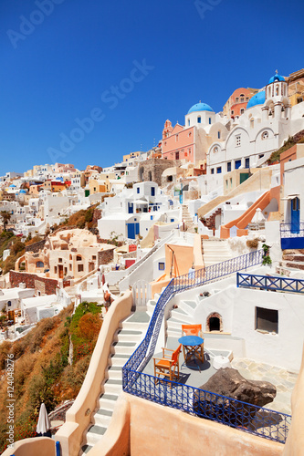 Foto op Canvas Oia town in Santorini, Greece with blue dome churches on foregro