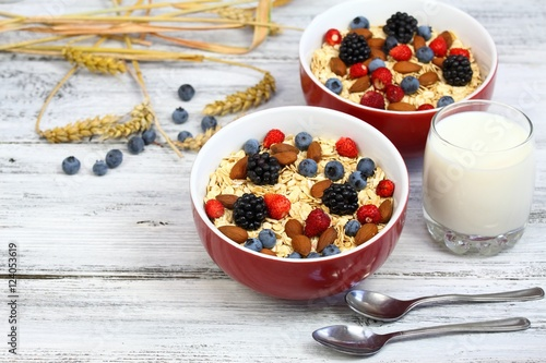 Staande foto Zuivelproducten Healthy homemade oatmeal breakfast, wild strawberries, blueberries & blackberries