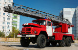red fire truck with a ladder.