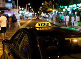 Taxi sign on the roof of a taxi at night - 124061845