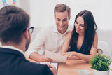 Fototapety Successful lawyer giving consultation to family couple about buy