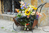 Decorative wood cart with artificial flowers