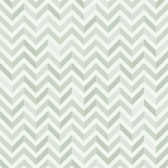 Seamless background in the geometric pattern of green colors