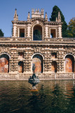 The Mercury Pond with Galeria de Grutescos (Grotto Gallery) in the garden of the Alcazar of Seville (Spain).