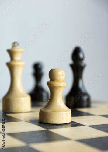 Poster chess pieces, pawns, Queen, officer, on the chess Board