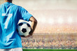 soccer football player in blue team concept holding soccer ball