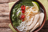 Vietnamese soup Pho Ga with chicken and rice noodles close-up. Horizontal top view