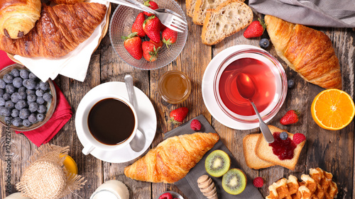 breakfast composition with coffee,tea,croissant and fruit © M.studio