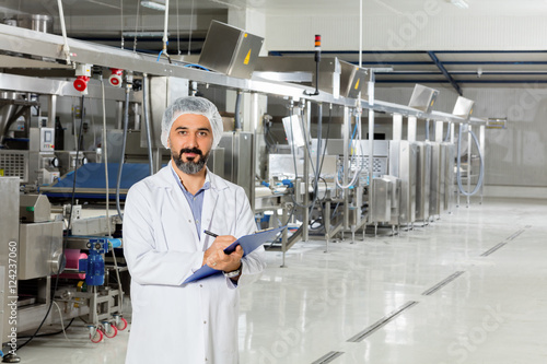 Man working at a food factory.